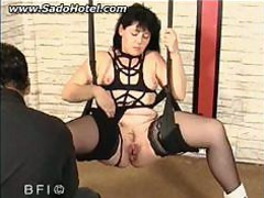 tied slave with her legs spread is nailed with a large