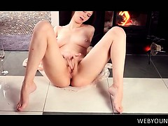 tempting-young-sex-siren-rubbing-and-finger-teasing-her-cunt