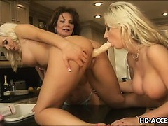 trio-of-lesbians-with-strap-on-and-toys
