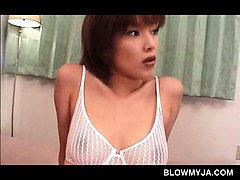 jap-babe-in-big-tits-licks-her-nipples-and-serves-two-dicks