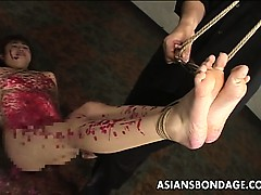 kinky-asian-slavegirl-gets-drenched-in-molten-wax