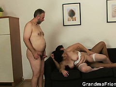 granny-in-white-lingerie-swallowing-two-cocks-after-pussy