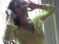 Sunny Leone slowly strips while caressing body passionately.