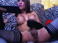hot-busty-shemale-jerking-her-big-hard-cock