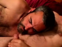 mature-gay-duo-sucking-cock-on-the-sofa