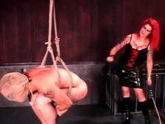 bdsm-redhead-mistress-spanking-male-ass-and-hard-balls