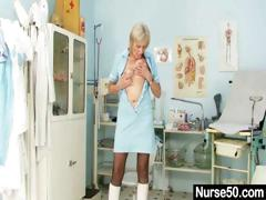 blonde-granny-nurse-self-exam-with-pussy-spreader