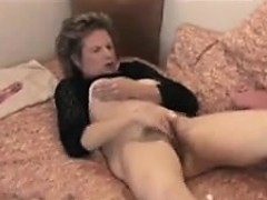 old bitch rubbing her hairy old pussy