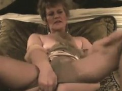 gilf-masturbating-with-her-toy-on-the-bed