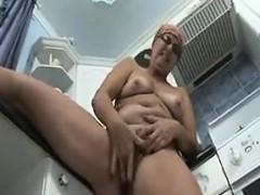 grandma-masturbates-at-home-in-the-kitchen