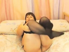 fat-mature-woman-shows-her-large-breasts