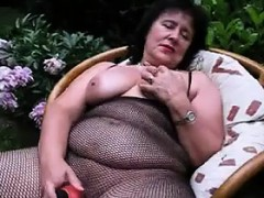 thick-granny-masturbates-with-a-dildo-outside