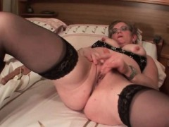 mature-in-glasses-fucks-herself-with-big-dildo