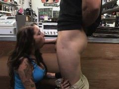 brunette sucking penis behind counter in pawn shop