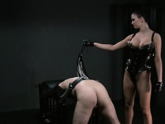 busty-mistress-flogging-bound-slave-in-dungeon