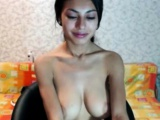 Good looking brunette latina plays with her big tits on cam