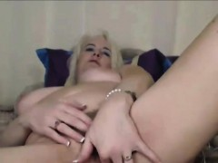 gorgeous-blonde-granny-titfuking-with-sextoy