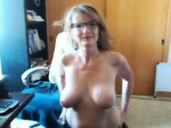 mature-woman-with-glasses-teasing