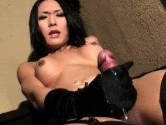 asian-shemale-masturbates-with-her-gloves-on