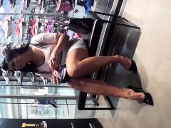 distinctive-brunette-revealing-her-sexy-long-legs-in-the-sh