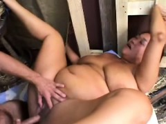 chunky mature lady has a hung cowboy hammering her holes in the barn