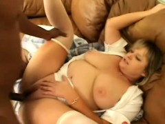Fat blonde sex kitten gets her pussy serviced on the couch by a black stud