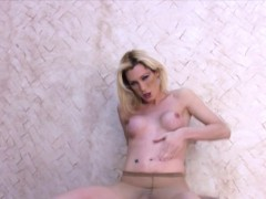 blonde-plays-with-her-long-cock-trapped-in-sexy-pantyhose