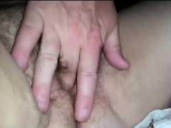 rubbing-and-fingering-her-hairy-mature-pussy