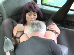redhead-ebony-in-stockings-fingered-in-cab