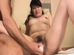 busty-oriental-milf-has-a-dildo-and-cock-driving-her-pussy