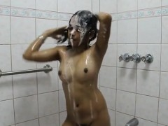 University Woman Having Washing And A Large Breasts