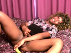 curly-haired-ebony-shemale-slips-banana-in-her-ass-and-jerks