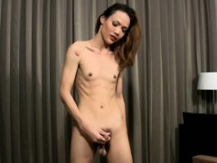 skinny-redhead-ladyboy-with-low-hanging-balls-tugs-two-cocks