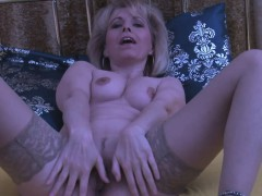 mature-blonde-displays-her-wet-love-tunnel