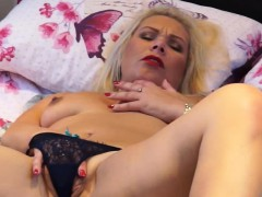 small-titted-blonde-mature-masturbating-on-the-bed