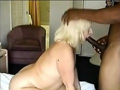 mature-blonde-big-tittied-milf-spreads-for-big-cock