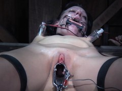 Sub babe gets her cunt spread with speculum
