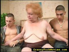 grandma-sucking-on-two-hard-dicks