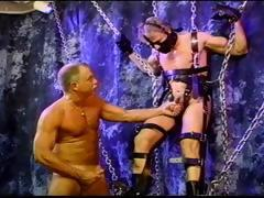 blond-muscle-stud-is-suspended-as-he-gets-his-balls-bashed