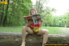 Pissing outdoor on a magazine - N