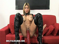 busty-blonde-fills-her-mouth-and-pussy-with-massive-dildos