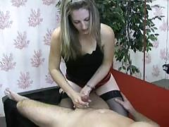 Masseuse Looks Focused As She Masturbates Her Client`s Cock