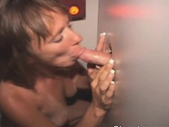 Mature Brunette Sucking Dicks Through A Glory Hole