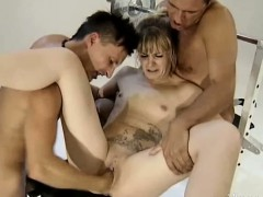 tattooed-blond-milf-fisted-by-two-studs