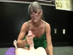 milf-offers-her-sensual-handjob-while-smoking