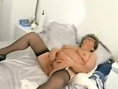 chubby-granny-with-glasses-masturbates