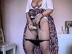 granny-masturbates-with-her-vibrator