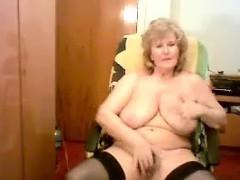 busty-granny-masturbates-on-a-cam-show