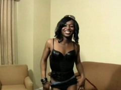 black-shemale-in-sexy-leather-corset-shaking-her-massive-ass