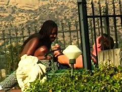 sensuous-black-babe-has-a-white-guy-pounding-her-snatch-under-the-sun